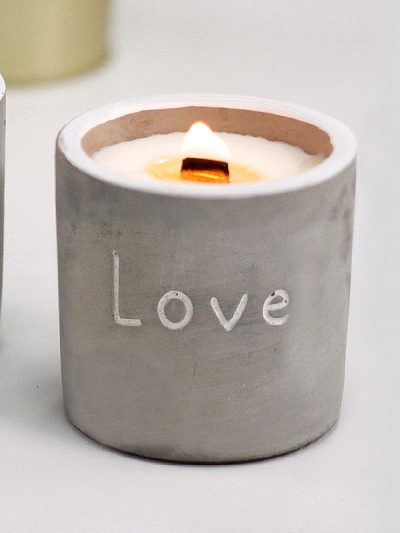 love candle with wooden stick concrete minimalist